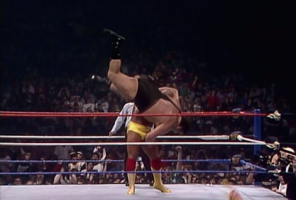 Hogan body slams Andre.